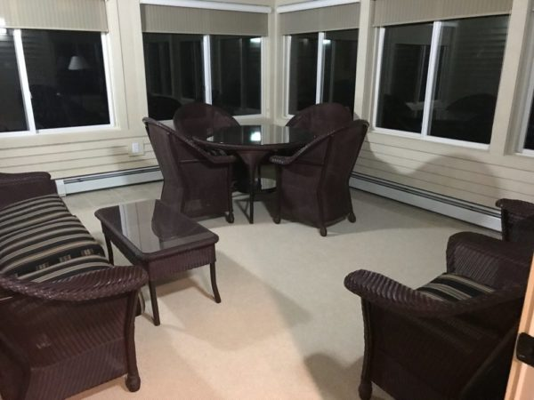 Smugglers Notch Resort Accommodations - North Hill Community Condominiums sun room
