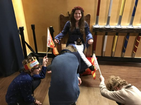 Boys kneeling to Jenn at Medieval Times in New Jersey photo credit Jersey Family Fun