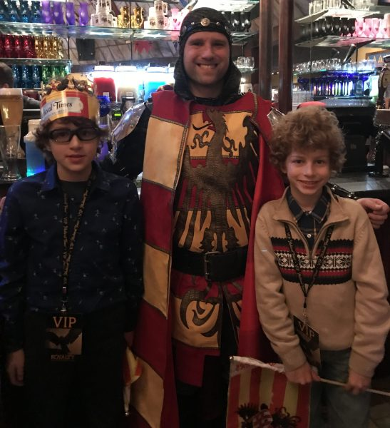 Boys with the red and yellow knight at Medieval TImes in New Jersey photo credit Jersey Family Fun
