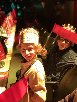 Boys cheering on the knights at Medieval Times Dinner and Tournament in New Jersey photo credit Jersey Family Fun