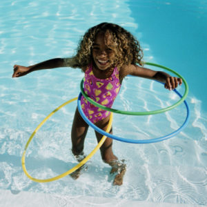 Girl Playing in a swimmng pool at Coliseum Camp