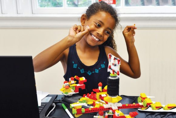 ESF camp girl building with blocks