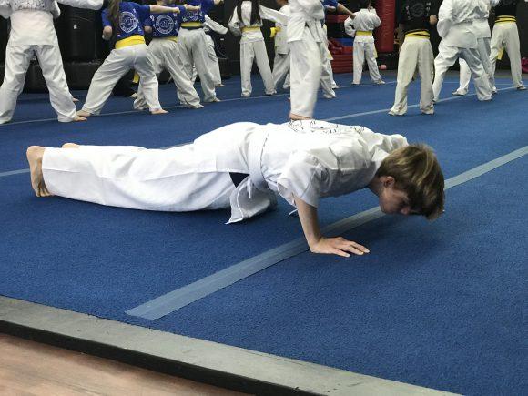 Doing pushups in Karate class at Mackenzie & Yates karate school in Hammonton