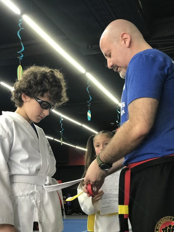 Earning stripes in karate class at Mackenzie and Yates Marial Arts in Hammonton