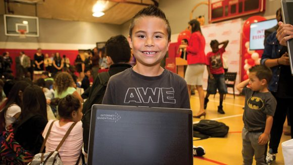 Internet Essentials Affordable Internet Access for NJ families hispanic kid gets laptop