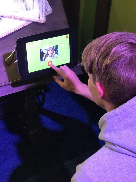 Teenager creates an elf id at HGTV Santa HQ at freehold mall