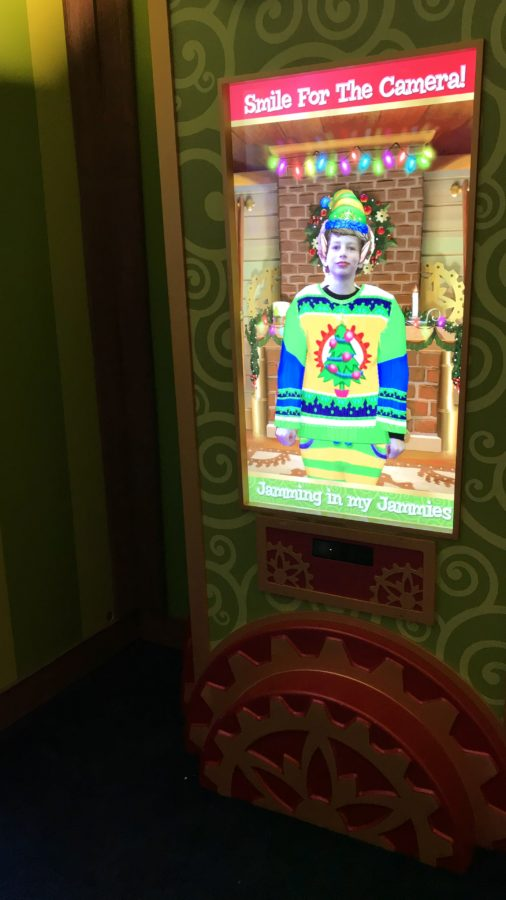 The magic mirror reveals a boy transformed into an elf with an ugly christmas sweater