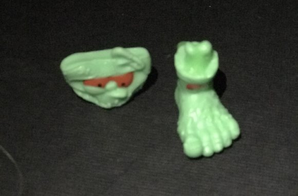 Two of the figures from the Zuru Smashers Series 2 – Gross Glow in the Dark collection are Dirty Diapers and Rotten Foot.