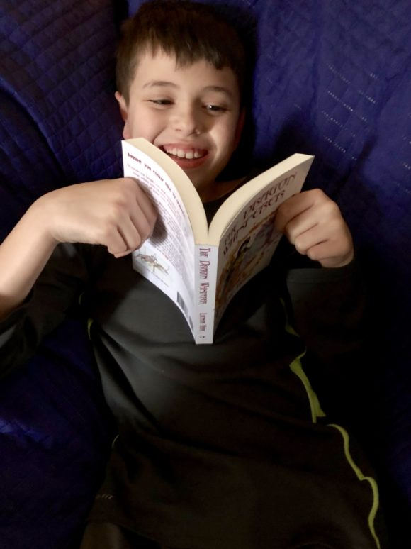 child reading The Dragon Whisperer By Lucinda Hare
