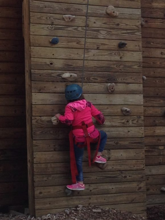 Climbing a wall at camp mason, one of NJ's sleepaway camps