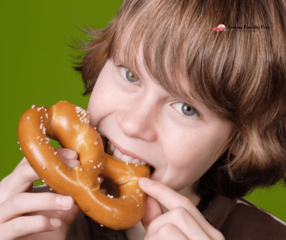 boy eating pretzel for free pretzel day in New Jersey
