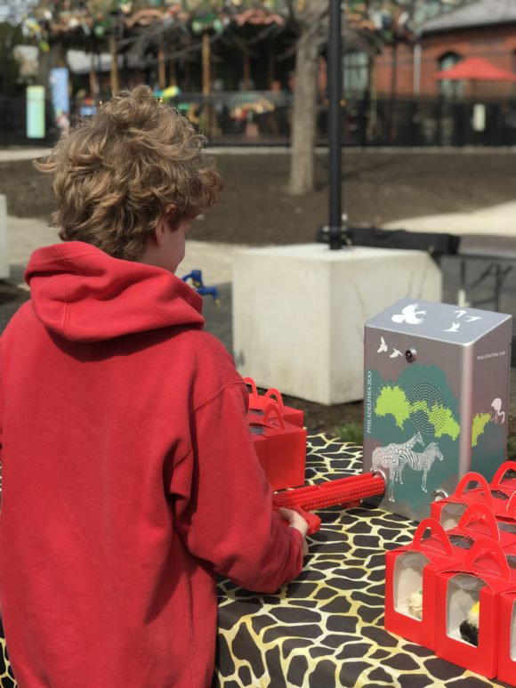 child unlocks an audio box at The Philadelphia Zoo with a lego key