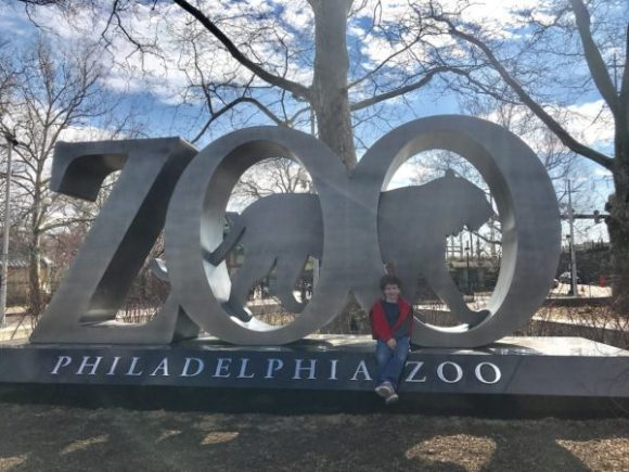 Image of child with the Philadelphia Zoo sculpture