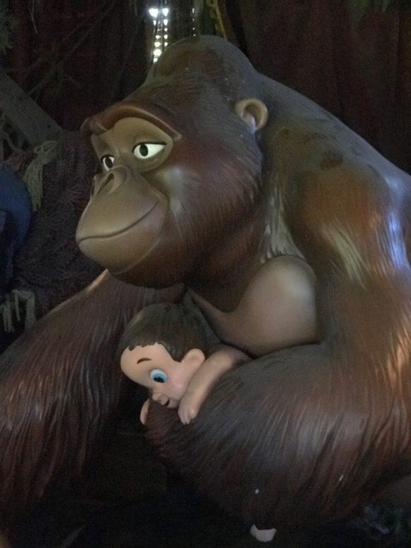 In Tarzans Treehouse a gorilla cuddles baby Tarzan.