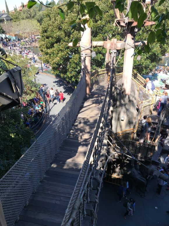 A rope bridge lets Disneyland guests explore Tarzans treehouse