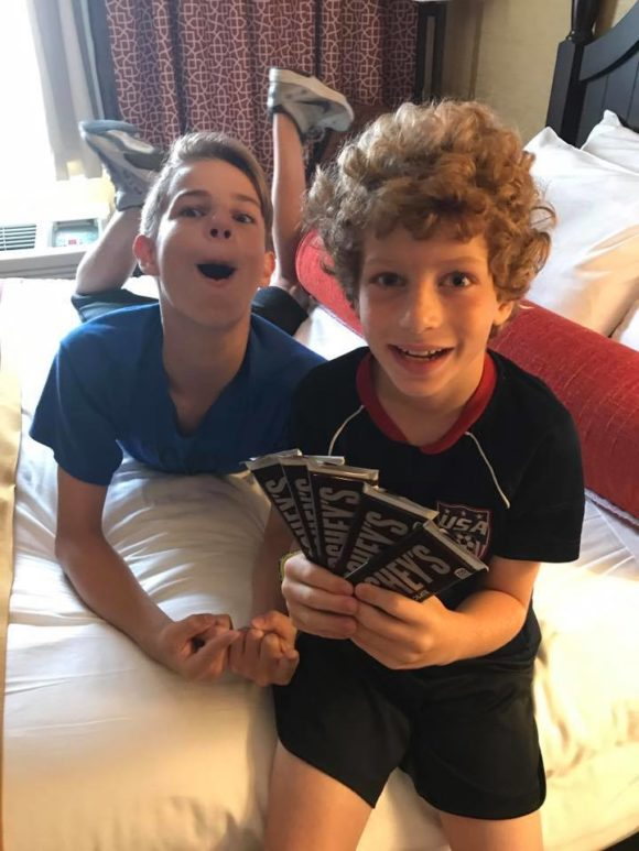 boys holding hershey chocolate bars