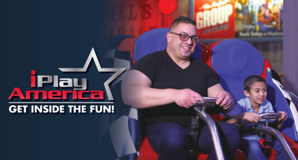 Dad and son riding a coaster at iPlay America with father's day offer listed