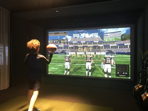 Teen plays quarterback challenge at iPlay America's Topgolf