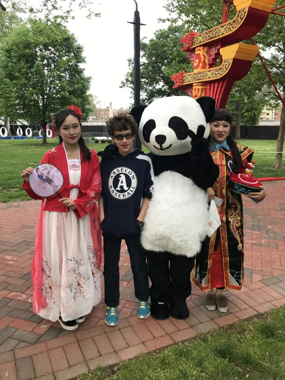 Posing with performers and mascots at the Philadelphia Chinese Lantern Festival
