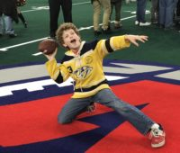 Boy on the football field of the AC Blackjacks at Boardwalk Hall in Atlantic City.
