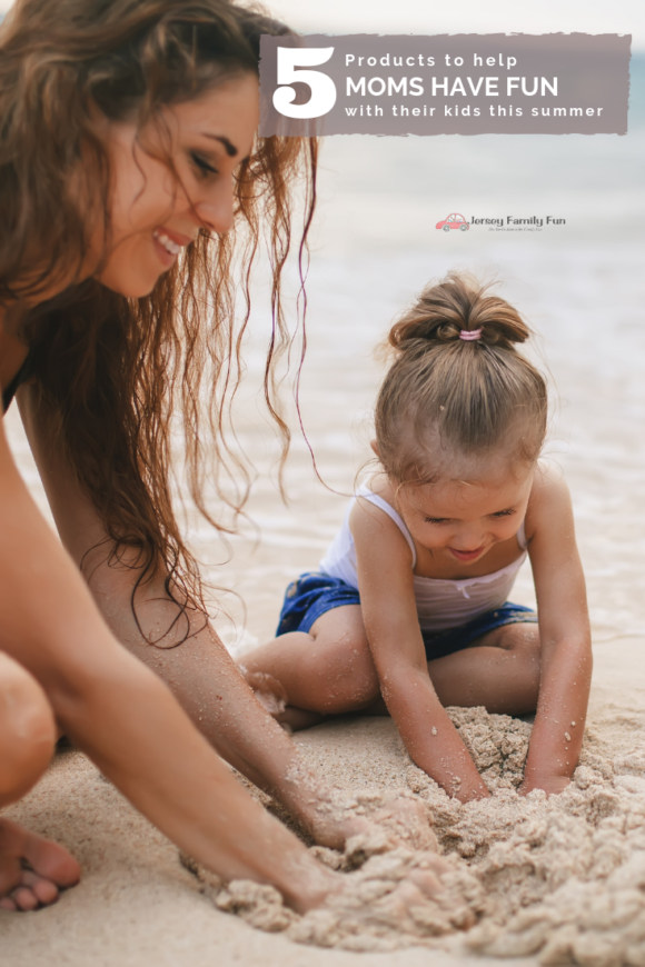 mom on beach with kid playing in the sand for article about products to help moms this summer