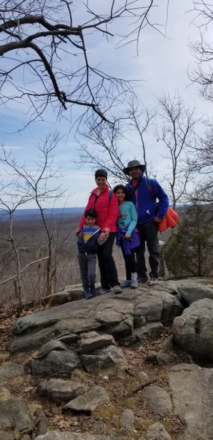 family standing on hiking trail of Pyramid Mountain National Historic Area in Boonton, NJ