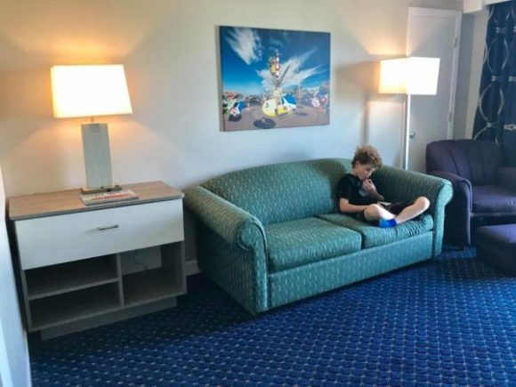 The Adventurer Oceanfront Inn family suite offers 2 spacious rooms. One has a sleepaway couch.
