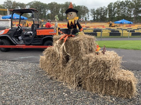 Scarecrows and haystacks add to the Diggerfest decor