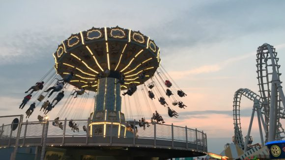Morey's Piers Swing Ride at sunset on the boardwalk in Wildwood
