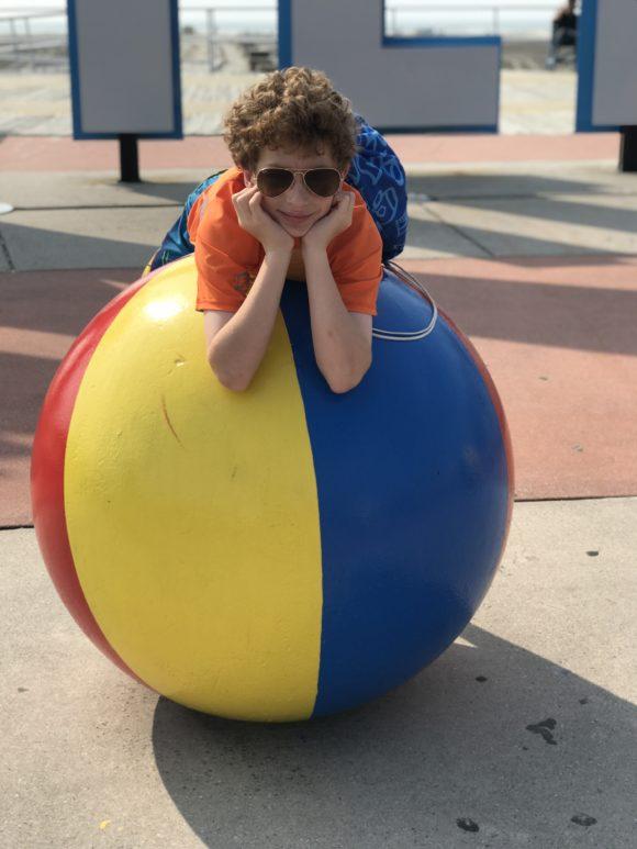 Boy on wildwood beach ball statue on Wildwood boardwalk