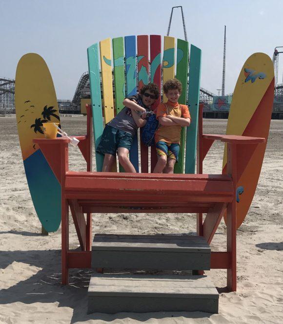 boys in wildwood adironack chair on Wildwood beach