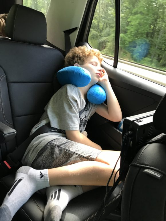 Boy asleep on leather seats in 2019 Chevy Traverse