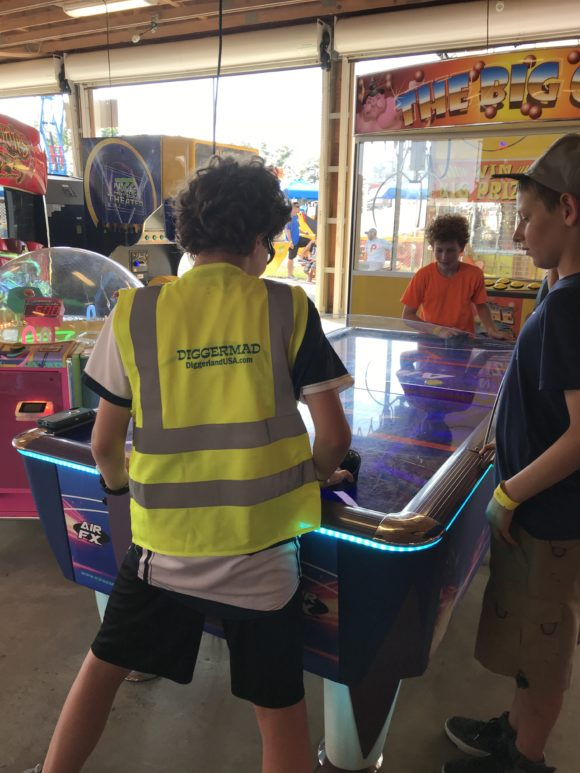 Boys playing air hockey in the arcade at Diggerland in West Berlin New Jersey