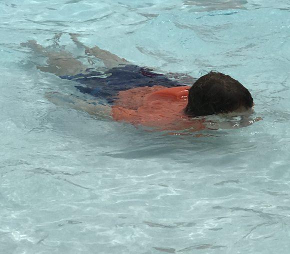 kid swimming at Calypso Springs the new pool at Six Flags Hurricane Harbor