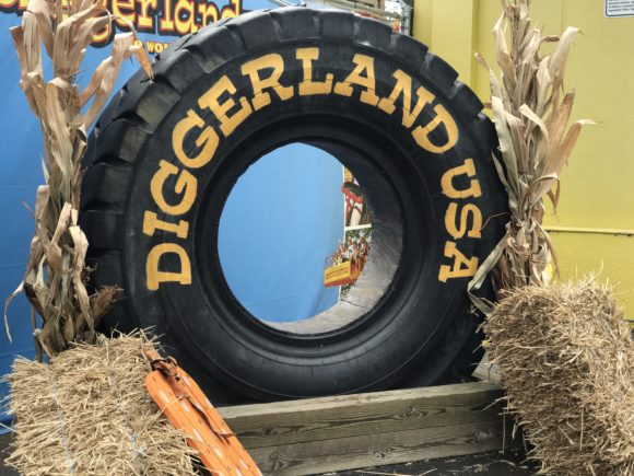 Diggerland tire at entrance with fall decor