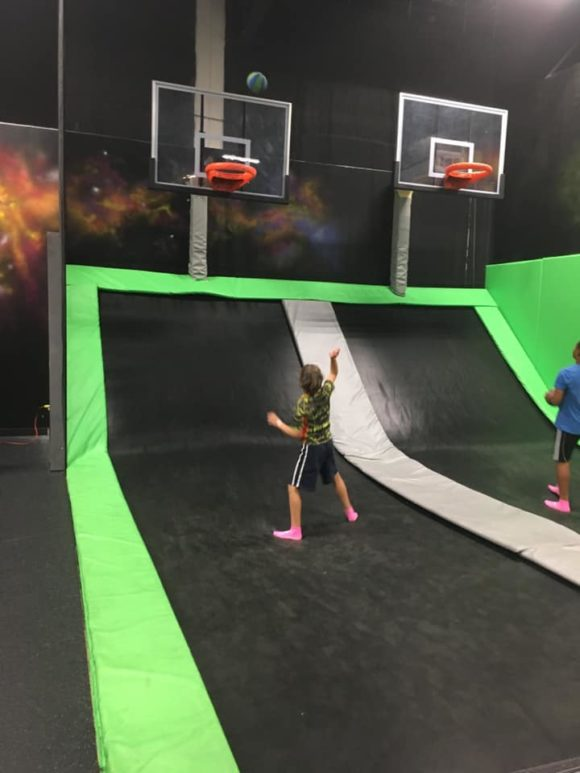 trampoline park boy playing basketball on a trampoline in New Jersey
