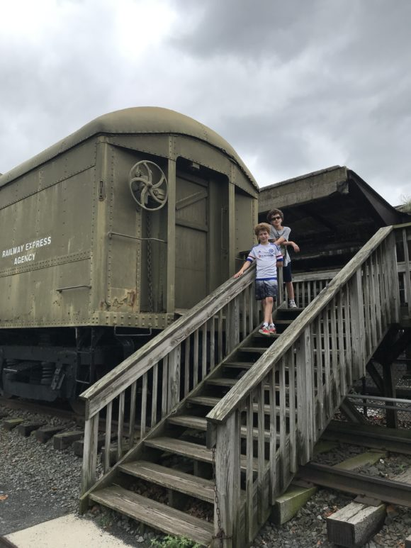 boys at trains at Central Railroad of New Jersey Terminal at Liberty State Park