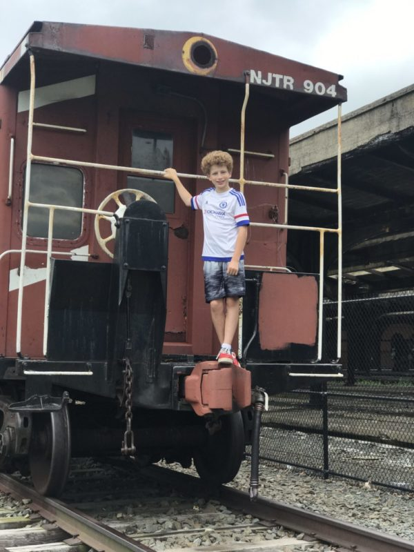 boy on train at Central Railroad of New Jersey Terminal at Liberty State Park in Jersey City