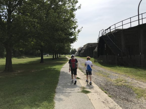 boys walking on trail at Fort Mott State Park