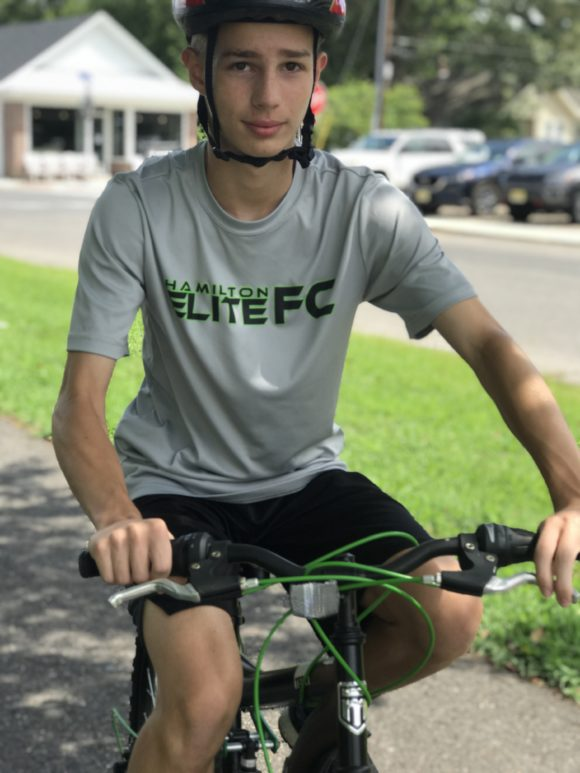 teen on bike wearing helmet