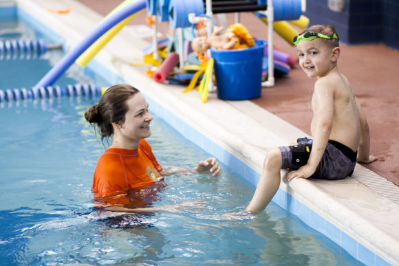 In turnersville a child prepares to take a swim class with Bear Paddle Swim School