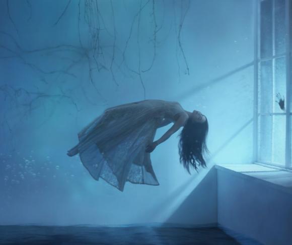 female ghost floats through the air