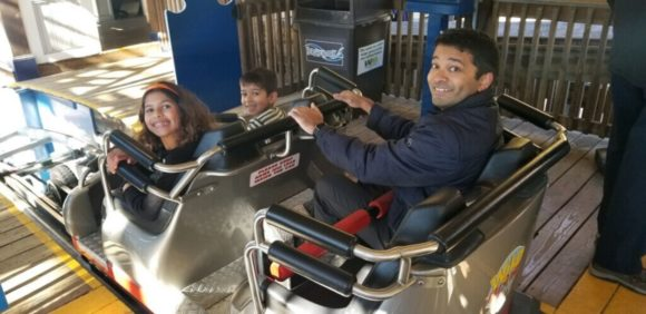 family prepares to ride roller coaster at Hersheypark.