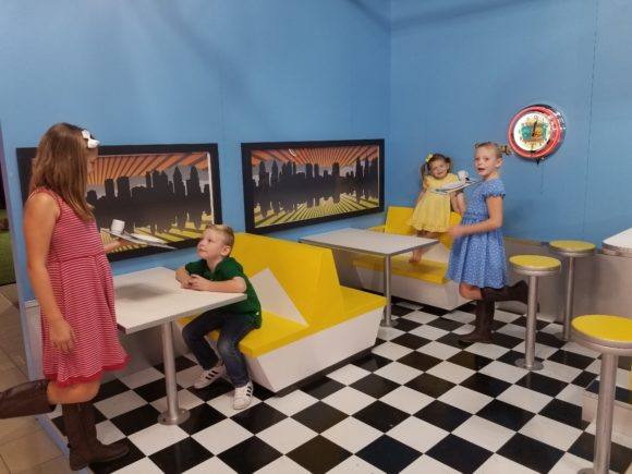 The diner in Happy Place Philadelphia serves up great family photos with kids serving kids