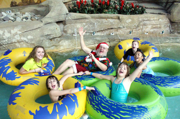 Santa in a water tube floating on the lazy river at Sahara Sam's