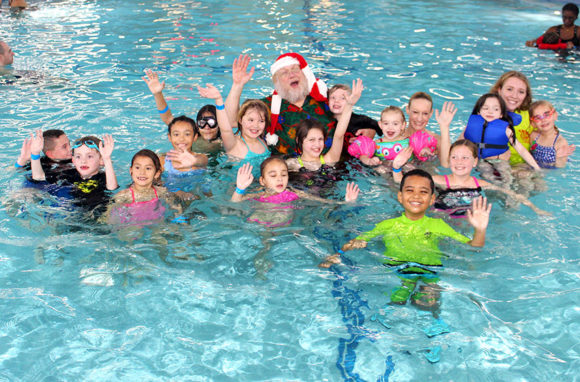 Santa swimming with kids at Sahara Sams