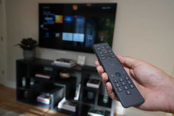 Philly Design Home 2019 man holding Xfinity X1 voice control remote
