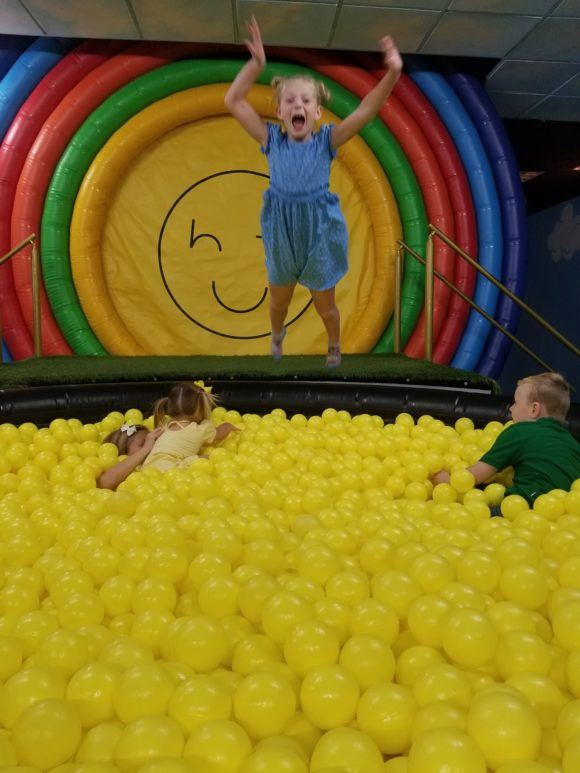 girl jumps into the pot of happiness at Happy Place