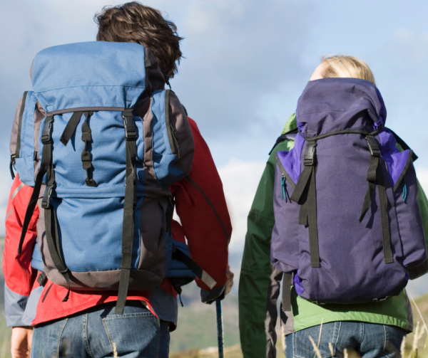 hiking female and male with backpacks on.