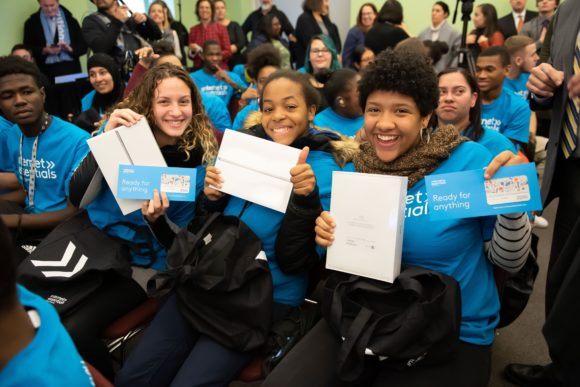 Comcast Digital Inclusion Rally Pennsylvania School for the Deaf 3 female students hold ipads and gift card to make 6 months of internet accessible